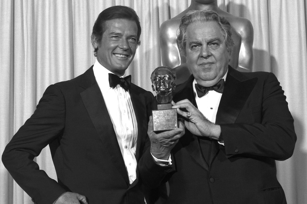 "Robert Moore and Albert R. ""Cubby"" Broccoli stand together at the Oscars"