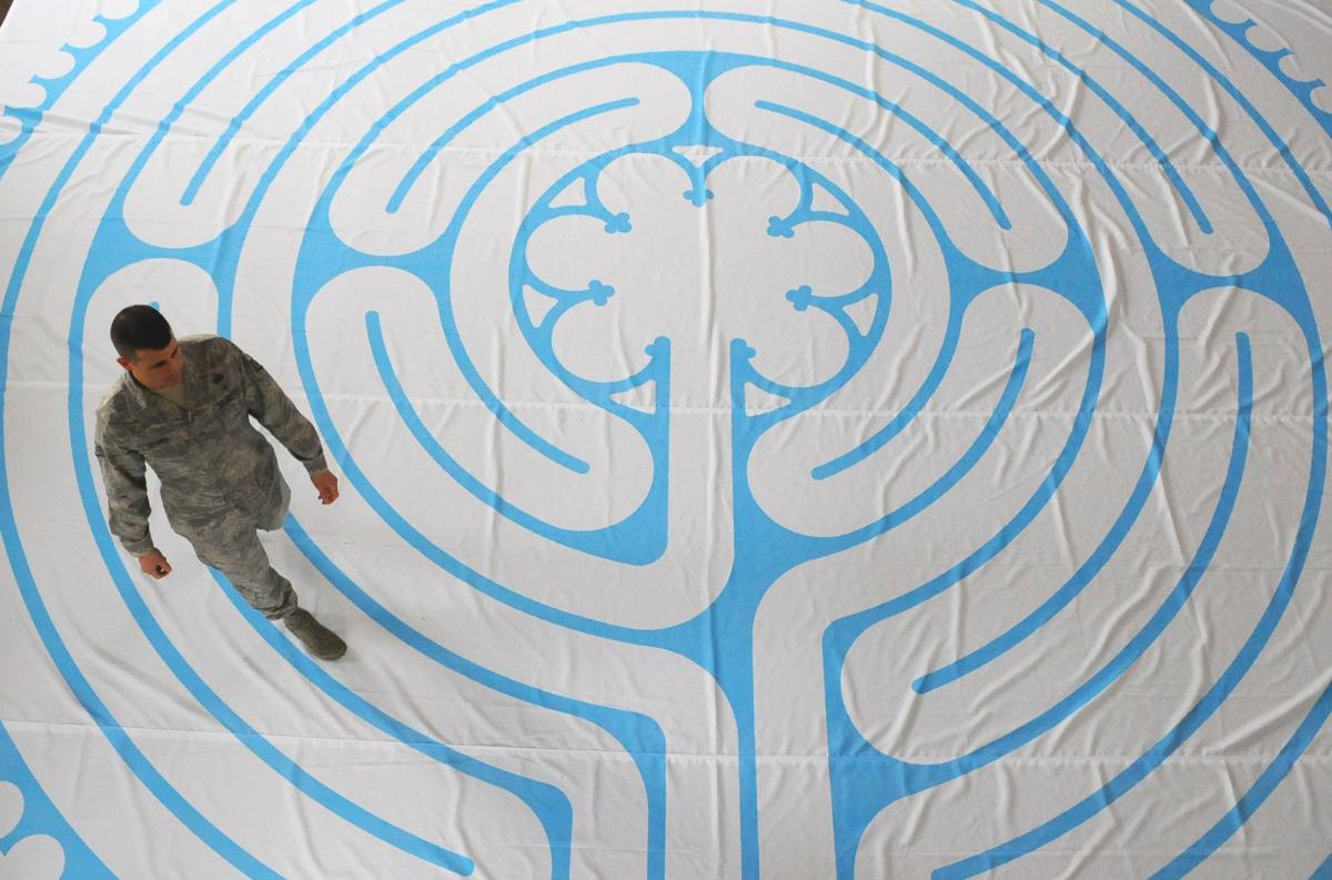 Soldier walks through a meditation labyrinth