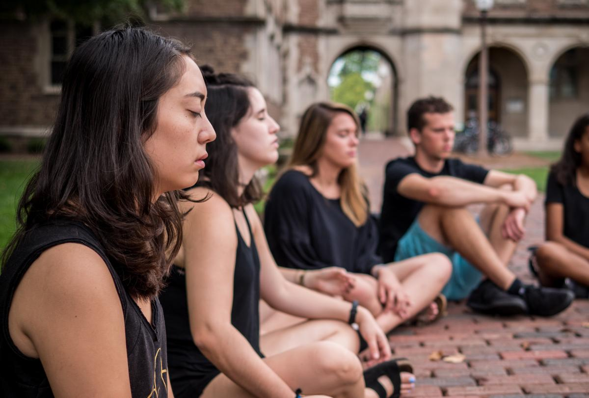Heather Rice's students meditate in the quad