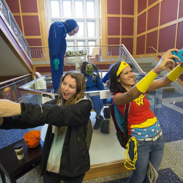 Students taking selfies for Trick or Tweet