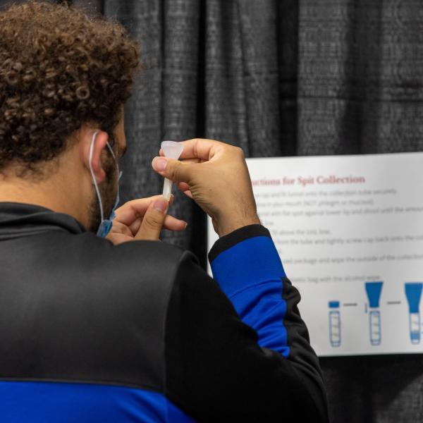 A student prepares a COVID-19 test.