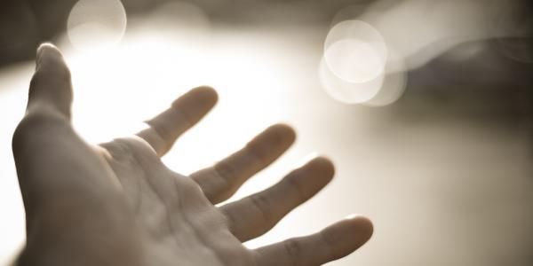 Hand and light