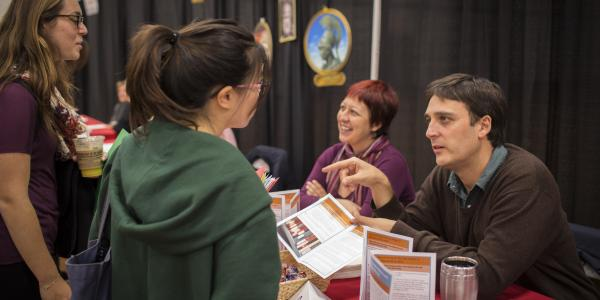 Students and faculty talk at the Major Minor Fair