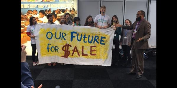 Students holding banner