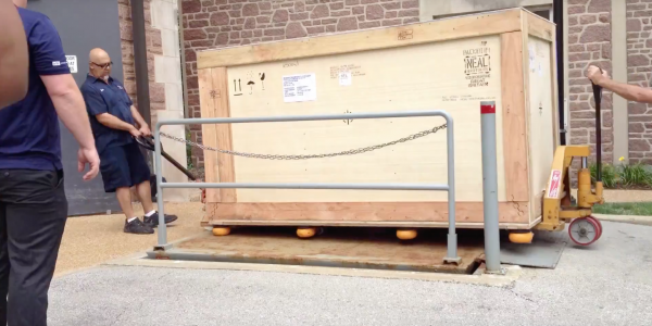 A large crate arrives at WashU