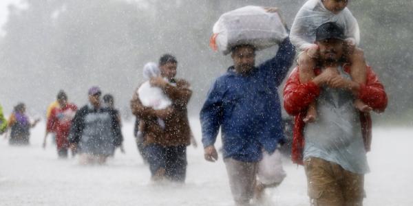 Hurricane Harvey Flooding Refugees Walk Through the Rain