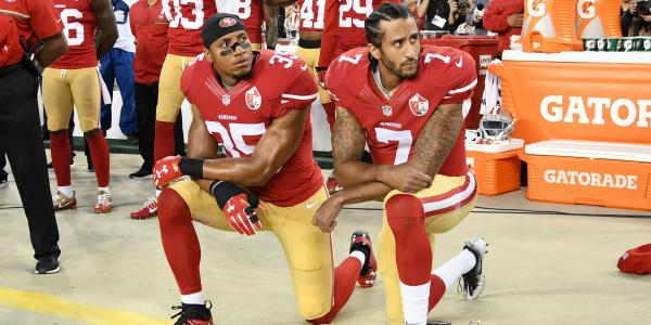 Colin Kaepernick kneeling with a collegue