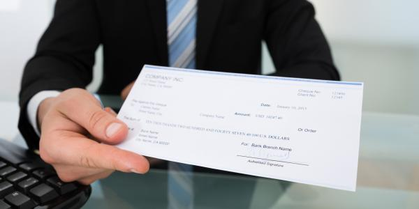 An employee recieves a paycheck