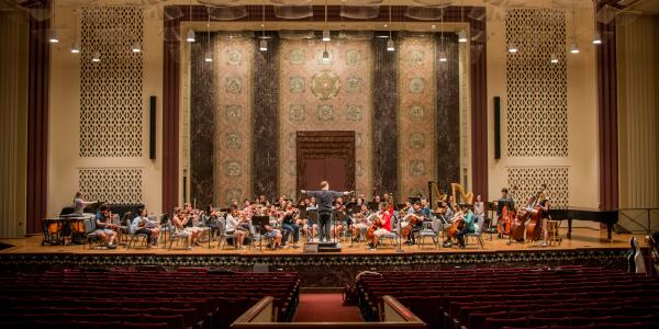 The WashU symphony orchestra in rehearsal at the 560 Music Center